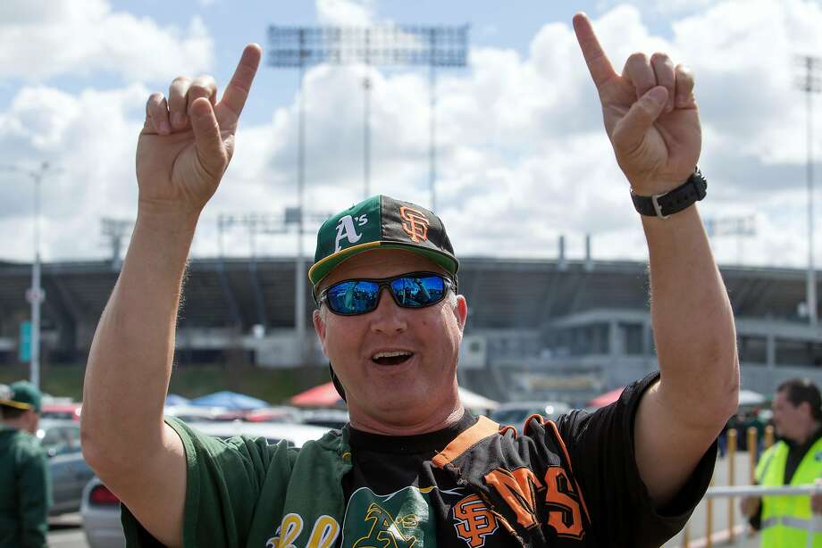 Jeff Kehr of San Ramon, whose loyalties are obviously split between the Oakland Athletics and San Francisco Giants, tailgates before a game of the Bay Bridge Series, on Sunday, March 25, 2018 in Oakland. Photo: D. Ross Cameron / Special To The Chronicle