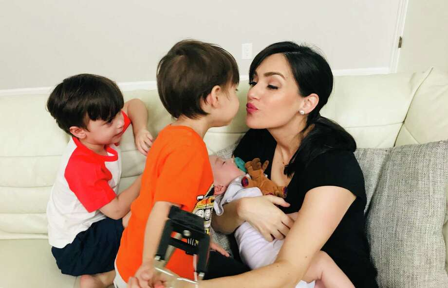 Returning KSAT anchorwoman Isis Romero said it's hard leaving behind the intensive bonding time — and lovely kisses —she enjoyed with baby, Noel, and two older boys, Elijah and Phillip. Photo: Courtesy Of Isis Romero /