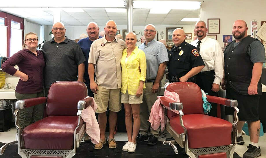 A few friends got together to show support for Dana Shepard in her fight against breast cancer. From left to right, Mayor Jeff Lambright, Councilman Troy Barton, Councilman Alvin Burress, his wife Dana Shepard, City Manager Theo Melancon, Capt. John Coleman, Chief John Headrick, and Adam Piserelle. Photo: Submitted