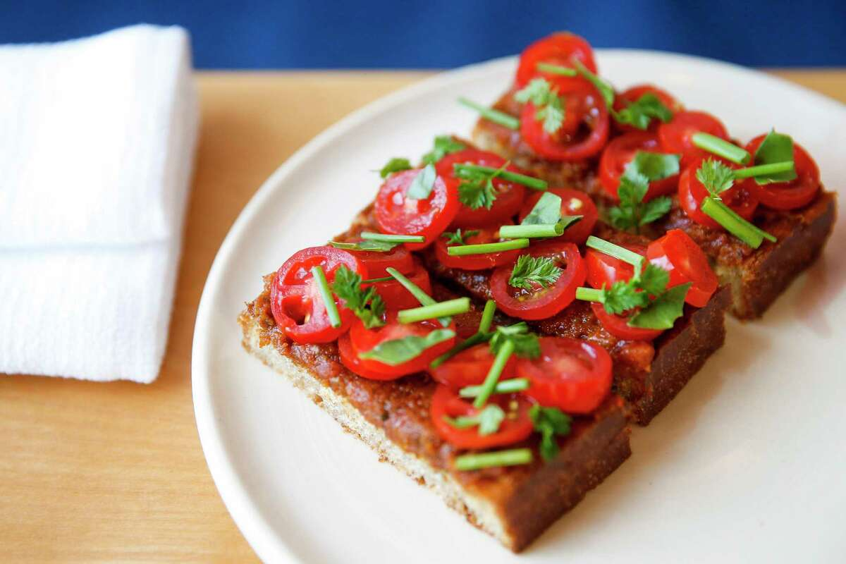 Tomato toast at Justin Yu's new restaurant, Theodore Rex, which Eater named as one of 2018 Best New Restaurants in America.