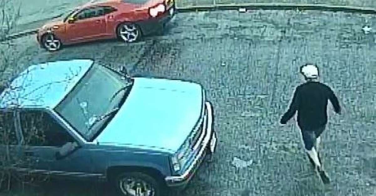 San Antonio police are looking for a suspected robber who got away in a red Chevrolet Camaro with a black bumper and black hood on Feb. 20, 2018.
