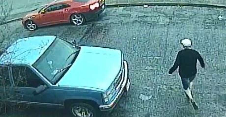 San Antonio police are looking for a suspected robber who got away in a red Chevrolet Camaro with a black bumper and black hood on Feb. 20, 2018. Photo: San Antonio Police Department