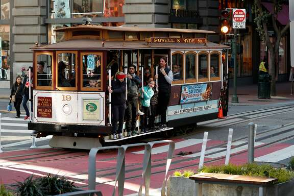 The Schmidgall family, (center) a party of seven visiting from Florida, purchased 6 adult fares, only one child was under 5 years old, to ride the world famous cable cars along the Powell st. line in San Francisco, Calif. on Mon. Mar. 26, 2018.