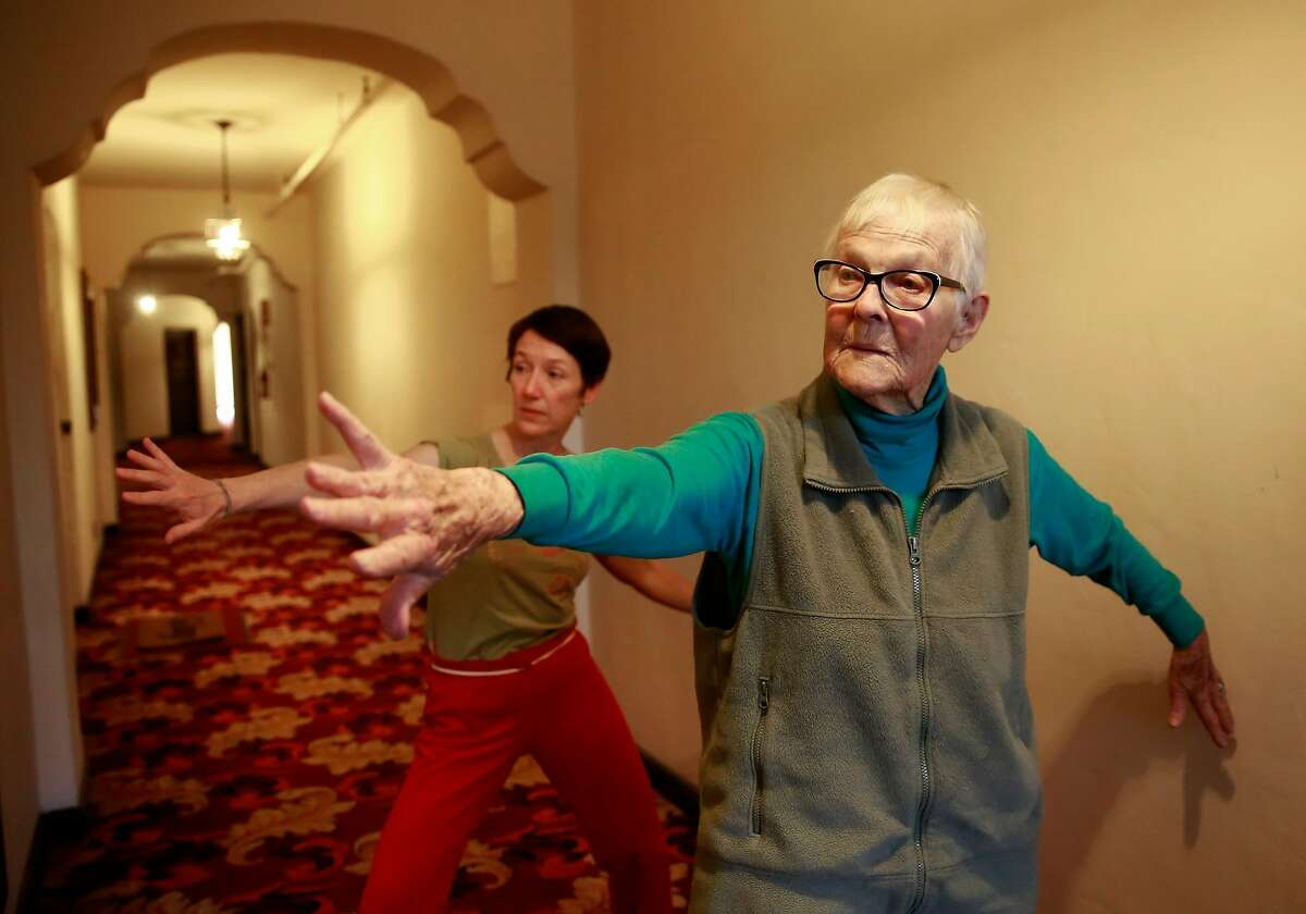 93-year-old dancer Judy Job and Christy Funsch artistic director the postmodern company Funsch Dance Experience, perform Tai Chi which Job teaches each week, seen on Wed. March 14, 2018 in Oakland, Ca.