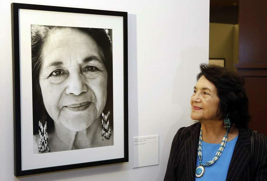"In this April 10, 2014, file photo, Dolores Huerta, co-founder of United Farms Workers stands by a portrait of herself taken in 1998 by photographer Angela Torres, as she tours her exhibition, ""Viva la Causa! Dolores Huerta and the Struggle for Justice,"" at La Plaza de la Cultura y Artes museum downtown Los Angeles. Photo: Damian Dovarganes, STF / Associated Press / Copyright 2018 The Associated Press. All rights reserved."