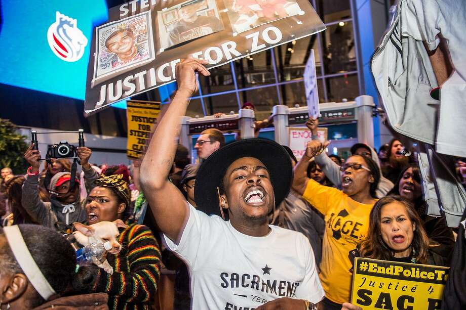 Stevante Clark, the older brother of Stephon Clark, joins supporters after they shut down the Golden 1 Center in Sacramento, Thursday, March 22, 2018. Photo: Hector Amezcua / TNS