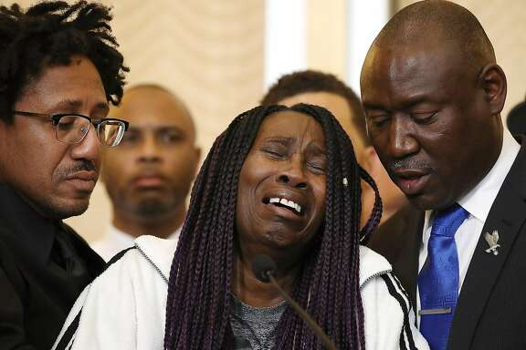 SACRAMENTO, CA - MARCH 26:  Sequita Thompson, (C) grandmother of Stephon Clark who was shot and killed by Sacramento police, cries as she speaks during a news conference with civil rights attorney Ben Crump (R) on March 26, 2018 in Sacramento, California. The family of Stephon Clark, an unarmed black man who was shot and killed by Sacramento police officers, have hired civil rights attorney Ben Crump to represent the Clark family in a wrongful death suit against the Sacramento police department.  (Photo by Justin Sullivan/Getty Images)