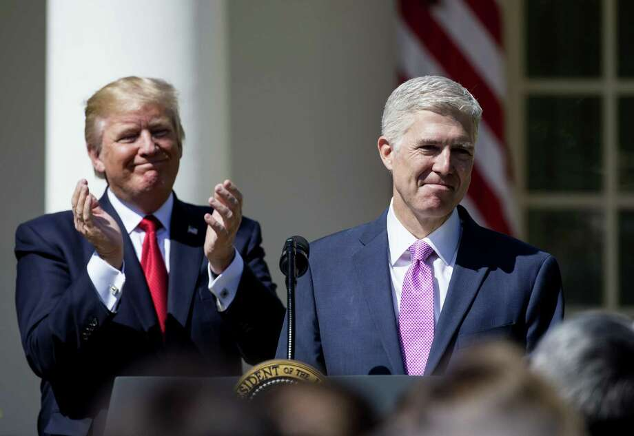 Key among the reasons evangelical voters continue to support President Trump: That would be Supreme Court Justice Judge Neil Gorsuch, shown there speaking as the president looks on during a ceremony in the Rose Garden at the White House April 10. Earlier in the day Gorsuch, 49, was sworn in as the 113th Associate Justice in a private ceremony at the Supreme Court. Photo: Eric Thayer / / 2017 Getty Images