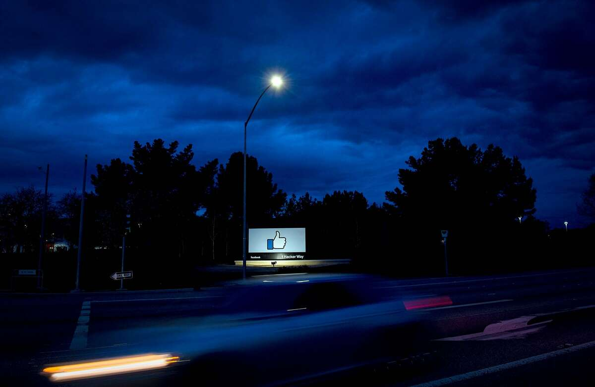 """TOPSHOT - A car passes by Facebook's corporate headquarters location in Menlo Park, California, on March 21, 2018. Facebook chief Mark Zuckerberg vowed on March 21 to """"step up"""" to fix problems at the social media giant, as it fights a snowballing scandal over the hijacking of personal data from millions of its users. / AFP PHOTO / JOSH EDELSONJOSH EDELSON/AFP/Getty Images"""