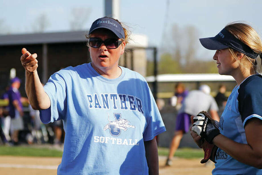 Jersey's coach Julie Muenstermann (left) talks to Chelsea Maag during a 22-10 Panthers win last season against Civic Memorial at the Bethalto Sports Complex. Maag is one of just two returning starters for Jersey, which takes on the task of rebuilding after four straight winning seasons. Photo: Billy Hurst / For The Telegraph