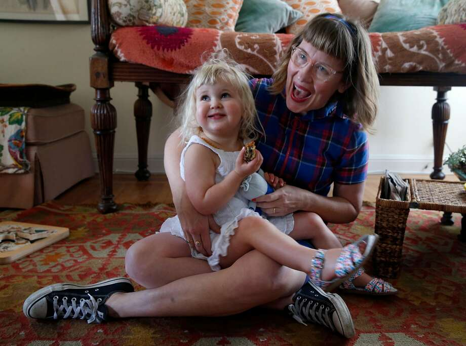 Girls Up Front co-founder Caitlin Williams Freeman with her 2½-year-old daughter Linden Pepper Freeman in San Francisco. Photo: Paul Chinn / The Chronicle