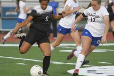 Steele's Ariana Nelson (8) prepares to send the ball downfield past Clemens' Emily Newton (17) and Alex Rudd (14) during Steele's 2-1 win Friday at Lehnhoff Stadium.