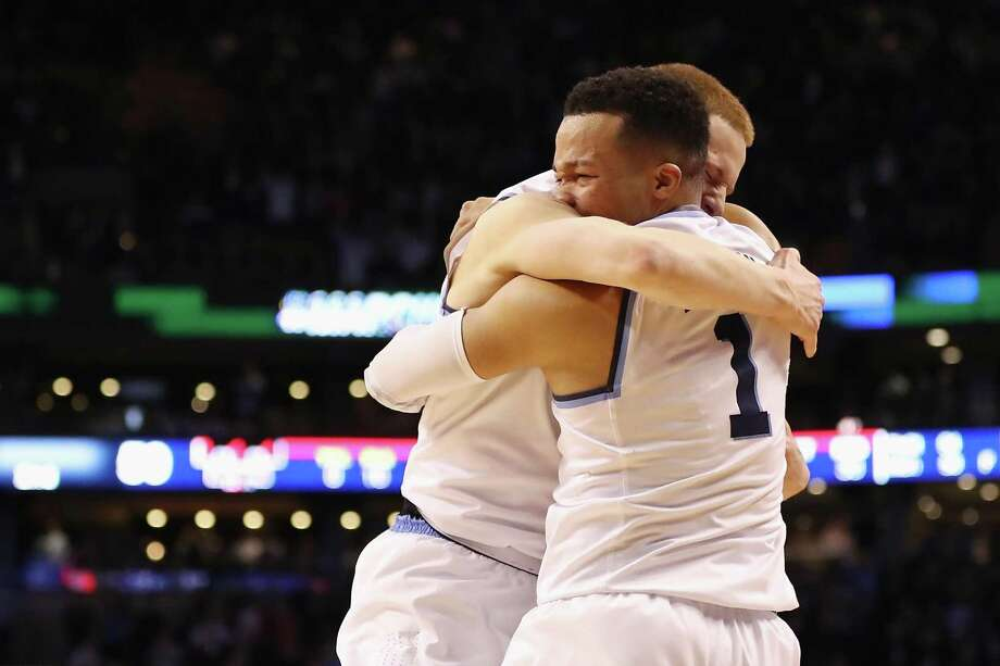 BOSTON, MA - MARCH 25:  Jalen Brunson #1 of the Villanova Wildcats celebrates with Donte DiVincenzo #10 after defeating the Texas Tech Red Raiders 71-59 in the 2018 NCAA Men's Basketball Tournament East Regional to advance to the 2018 Final Four at TD Garden on March 25, 2018 in Boston, Massachusetts.  (Photo by Elsa/Getty Images) Photo: Elsa, Staff / Getty Images / 2018 Getty Images