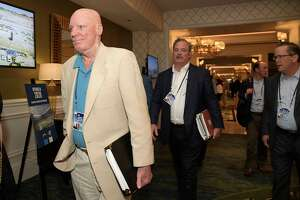 Houston Texans owner Bob McNair, left, and vice chairman Cal McNair, center, leave a conference room during the NFL owners meetings, Monday, March 26, 2018 in Orlando, Fla. (Phelan M. Ebenhack/AP Images for NFL)