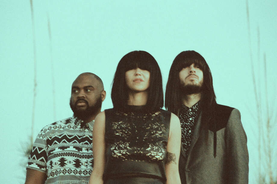"Khruangbin is a band from Houston that mixes global sounds including Thai funk, Jamaican dub and American surf guitar music. The band includes bassist Laura Lee, guitarist Mark Speer and drummer Donald ""DJ"" Johnson. Photo: Mary Kang"