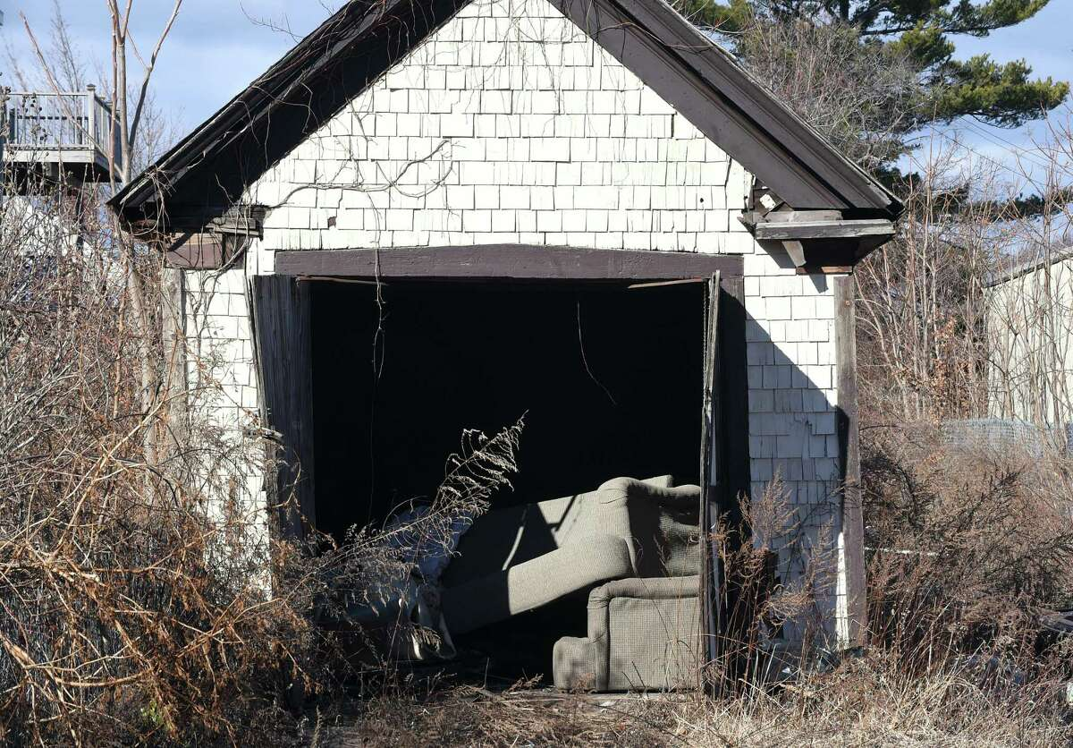 A garage facing Center St. in West Haven photographed on January 24, 2018 is slated for demolition to make way for The Haven upscale outlet mall.