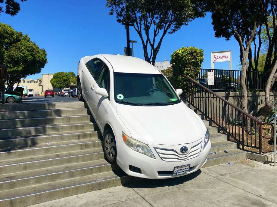 An Uber driver searching for an exit in the parking lot at the Church and Market Safeway instead got stuck on a stairway Monday afternoon. Photo: Steven Bracco/Hoodline