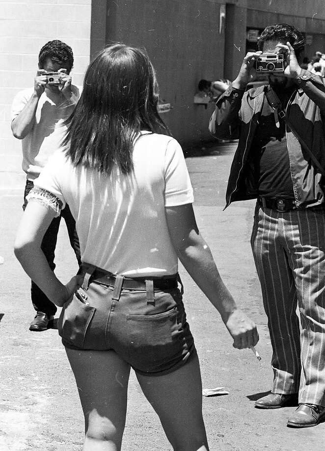 """June 27, 1971: Male fans use their free cameras on """"Hot Pants Day"""" at the Oakland Coliseum - a 1971 A's promotion where women in short tight shorts were given free tickets. Photo: Vincent Maggiora, The Chronicle"""