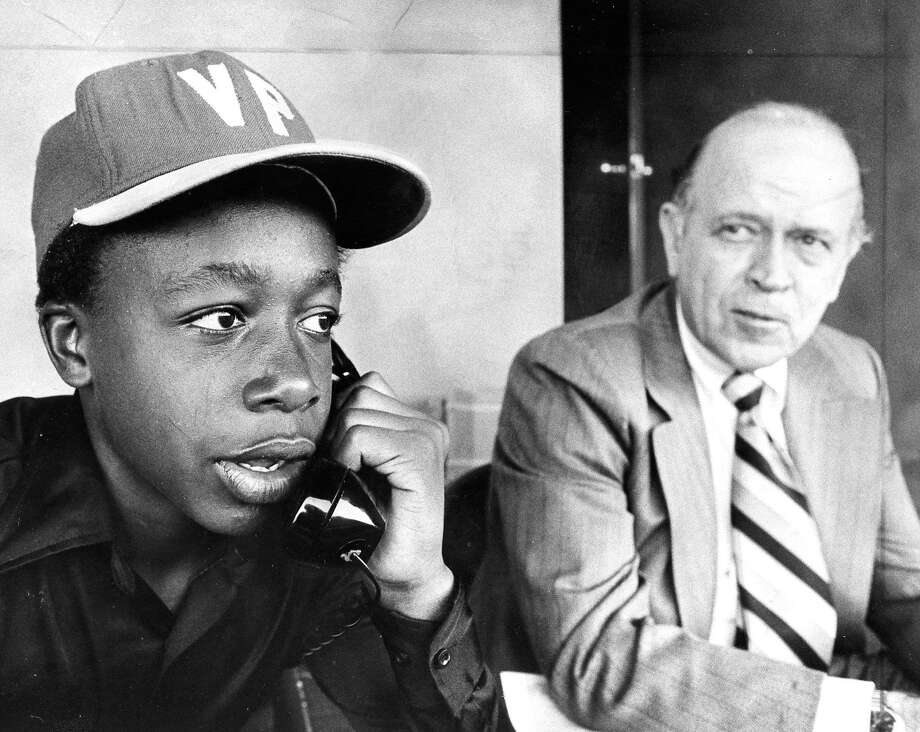 Stanley K. Burrell, AKA MC Hammer, during his time as a vice president for the Oakland A's. That's Charlie O. Finley on the right. Photo: Associated Press