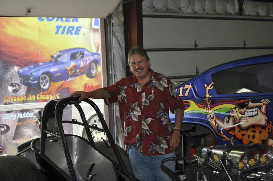 "Henry M. Gutierrez Jr., who was killed Dec. 24, 2015, poses here with ""funny cars,"" drag racers that usually have fiberglass bodies over a custom-built frame. He owned three of the cars, which competed in the national drag racing circuit, his family said. Photo: Courtesy /"