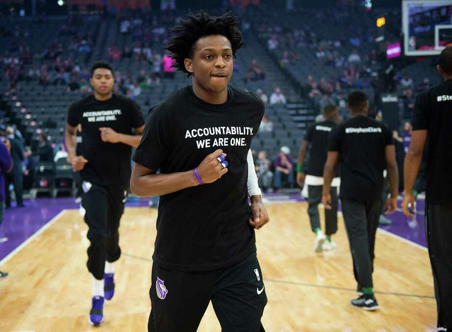 """Sacramento Kings forward Justin Jackson (25) wears a T-shirt bearing the name of Stephon Clark during a game at Golden 1 Center on Sunday March 25, 2018 in Sacramento, Calif. The Kings and Celtics wore shirts bearing the name of the unarmed man, Stephon Clark, who was killed by Sacramento police. The black warm-up shirts have """"Accountability. We are One"""" on the front and """"Stephon Clark"""" on the back. Photo: Paul Kitagaki Jr., MBR / TNS / Sacramento Bee"""