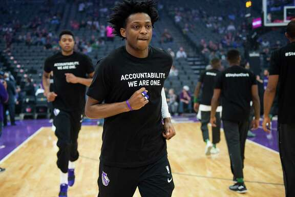 "Sacramento Kings forward Justin Jackson (25) wears a T-shirt bearing the name of Stephon Clark during a game at Golden 1 Center on Sunday March 25, 2018 in Sacramento, Calif. The Kings and Celtics wore shirts bearing the name of the unarmed man, Stephon Clark, who was killed by Sacramento police. The black warm-up shirts have ""Accountability. We are One"" on the front and ""Stephon Clark"" on the back."