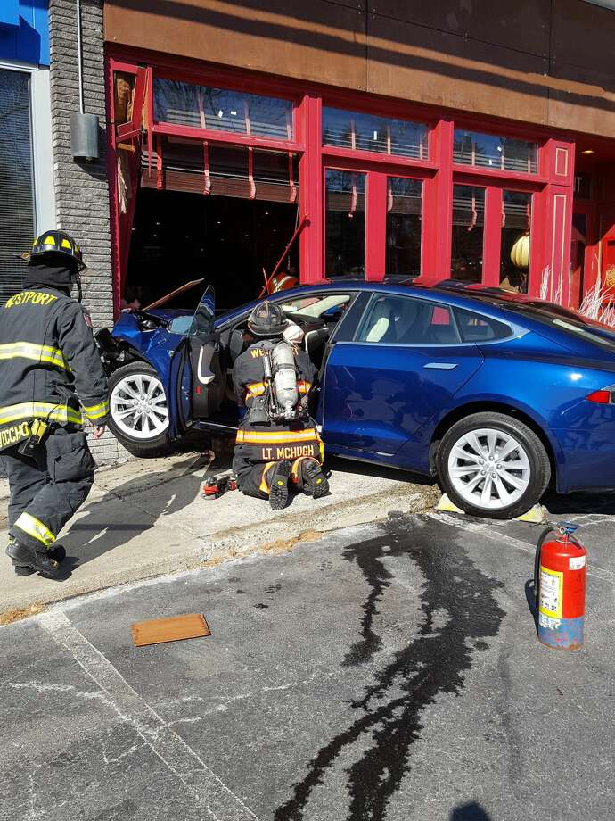 The Westport Fire Department responded to a restaurant on Post Road East after a car drove into the building on March 26. Photo: Westport Fire Department