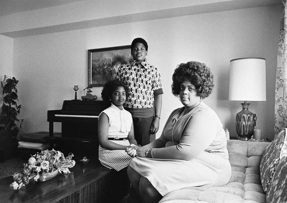 In this April 30, 1974, file photo, Linda Brown, right, and her two children pose for a photo in their home in Topeka, Kan. Brown, the Kansas girl at the center of the 1954 U.S. Supreme Court ruling that struck down racial segregation in schools, has died at age 76. Peaceful Rest Funeral Chapel of Topeka confirmed that Linda Brown died Sunday, March 25, 2018. (AP Photo, File) Photo: Uncredited / Copyright 2018 The Associated Press. All rights reserved.