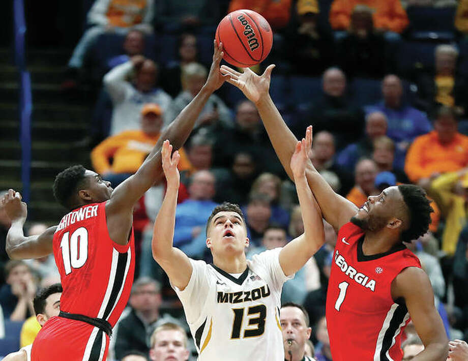 Missouri's Michael Porter Jr. (13) reaches for a rebound between Georgia's Teshaun Hightower (10) and Yante Maten (1) during a Southeastern Conference Tournament game earlier this month in St. Louis. Porter Jr. declared for the NBA Draft Monday. Photo: AP