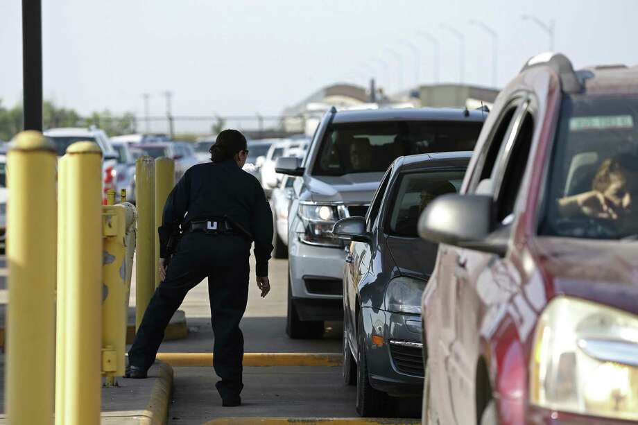 A Customs and Border Patrol officers checks for proper documents while working the Anzalduas International Bridge as Semana Santa, (Holy Week) traffic starts, Sunday, March 25, 2018. Photo: JERRY LARA /San Antonio Express-News / San Antonio Express-News