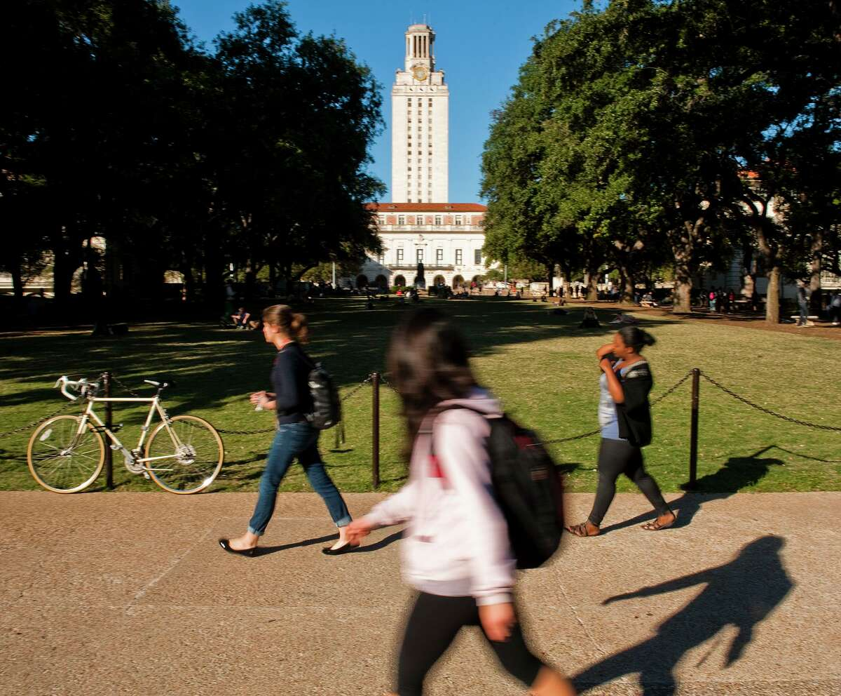 University of Texas at Austin students and faculty make their way through campus via the UT Tower in this file photo. The university will decide at the end of June 2020 whether it will have an in-person or online fall semester due to the novel coronavirus COVID-19, President Gregory Fenves announced on Thursday, April 23, 2020.