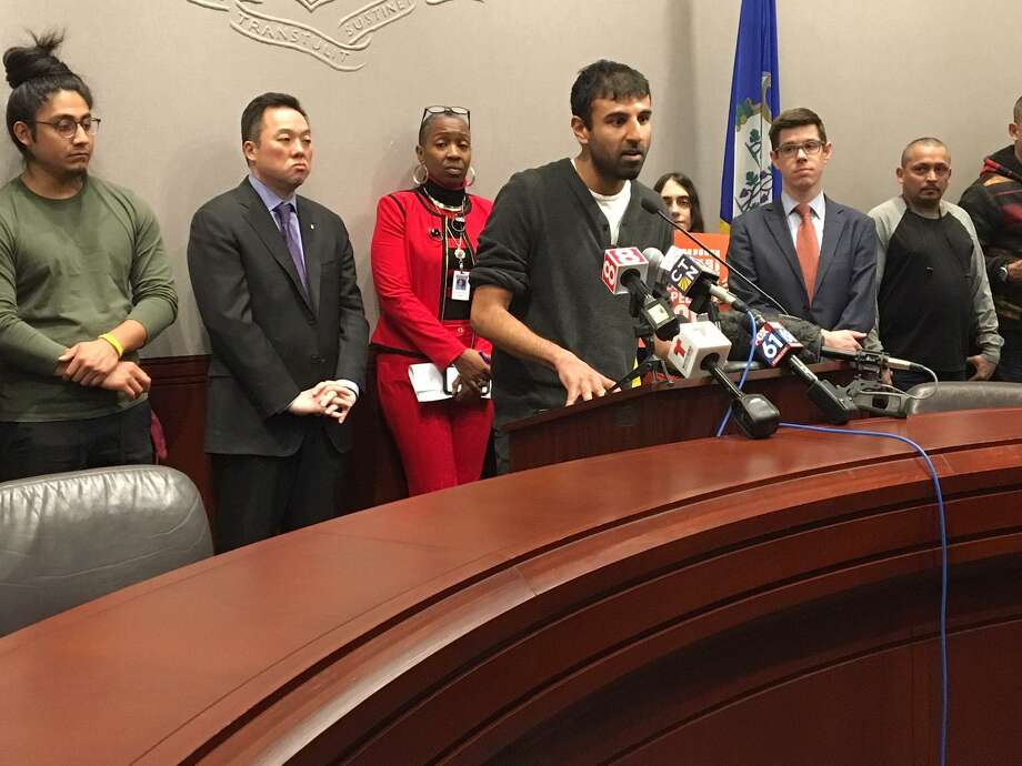 Alok Bhatt of the Connecticut Immigrant Rights Alliance leads a news conference on updating the Connecticut Trust Act and amending sentencing for misdemeanors. Behind him, from left, are Erik Cruz, state Rep. William Tong, state Rep. Robyn Porter and David McGuire. Photo: Mary E. O'Leary / Hearst Media Connecticut