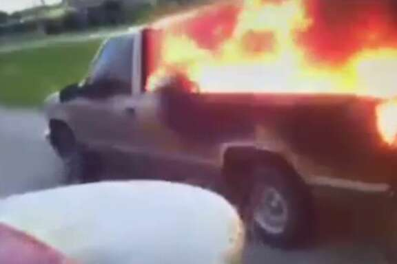 Video captured by a firefighter's helmet camera provides a first-hand look at what battling a vehicle fire is like.