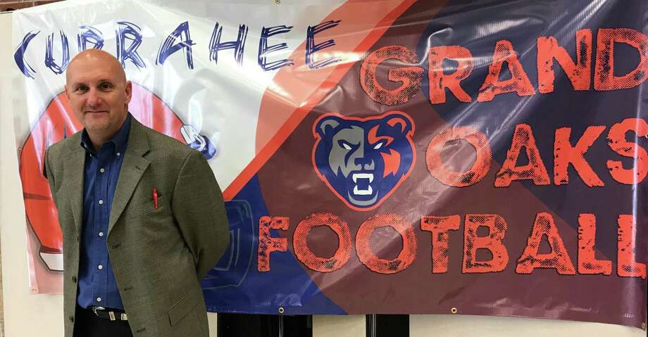 Grand Oaks head football coach and campus athletic director Mike Jackson posses for a photo before a special event introducing more than a dozen newly-hired coaches to students and parents on Monday night. Photo: Staff Photo By Justin Maskulinski
