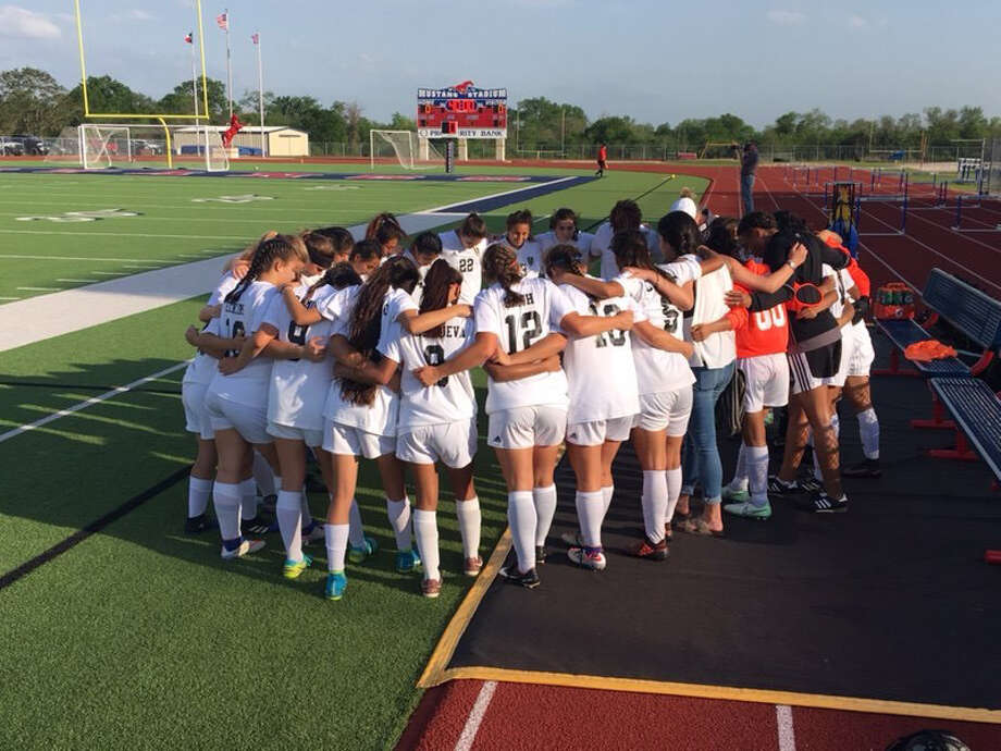 The Conroe girls soccer players huddle up before their District 12-6A play-in game on Monday evening at Madisonville High School. Photo: Staff Photo By Rob Tate