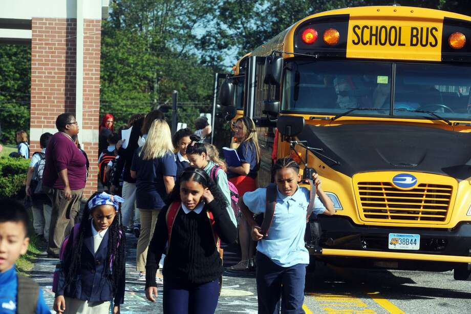 Students disembark school buses at Prendergast Elementary School on the first day of school in Ansonia, Conn. Aug. 28, 2018. Photo: Ned Gerard / Hearst Connecticut Media / Connecticut Post