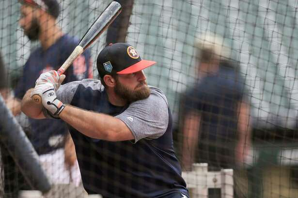 Houston Astros third baseman Tyler White (13) gets ready to hit a ball during batting practice before a pre-season game agianst the Milwaukee Brewers at Minute Maid Park on Monday, March 26, 2018, in Houston.