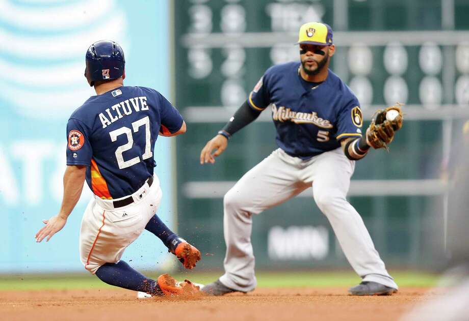 Houston Astros second baseman Jose Altuve (27) is out at first uner second baseman Jonathan Villar (5) in the first inning  at Minute Maid Park on Monday, March 26, 2018, in Houston. Photo: Elizabeth Conley, Houston Chronicle / © 2018 Houston Chronicle