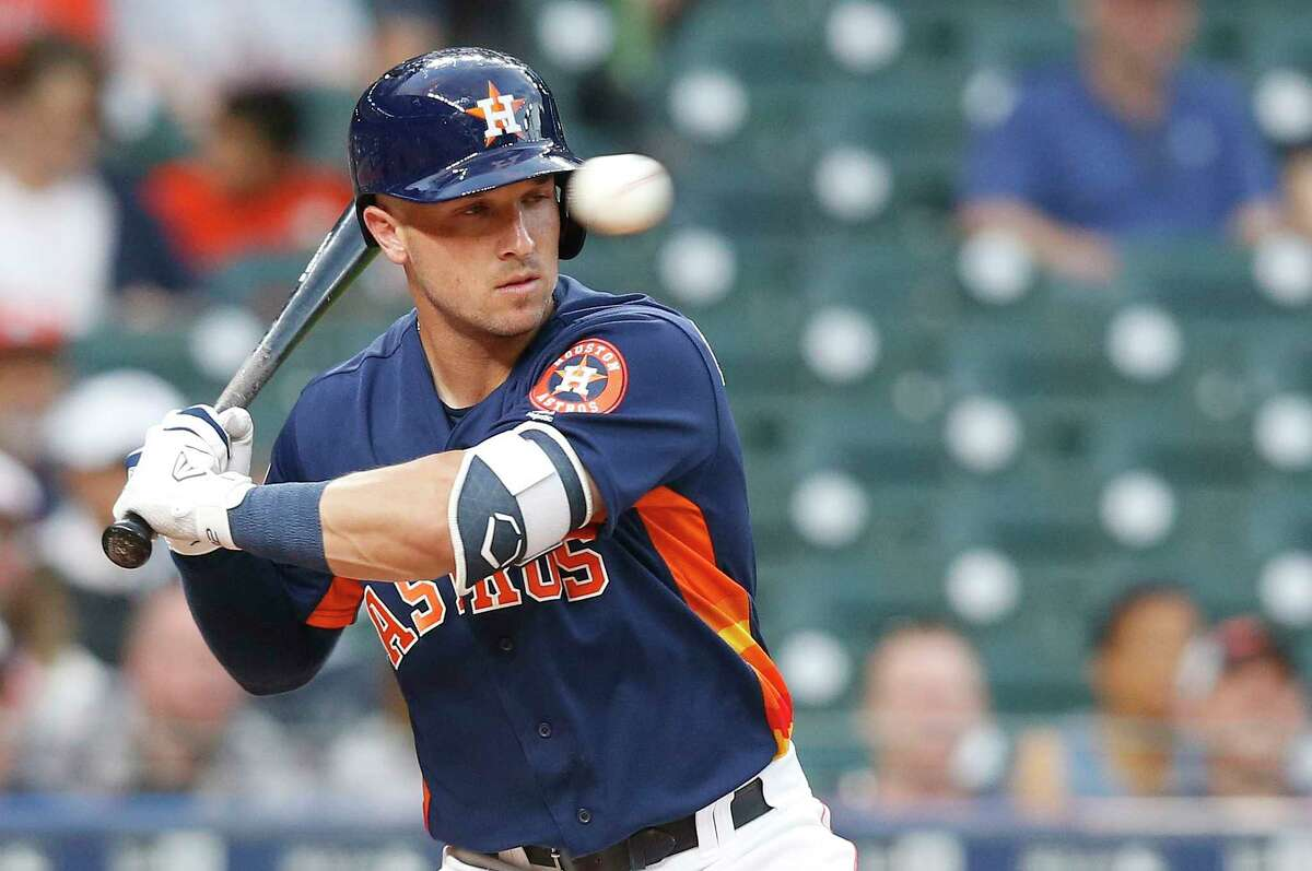 Houston Astros third baseman Alex Bregman (2) watches a ball pitch in the first inning against the Milwaukee Brewers at Minute Maid Park on Monday, March 26, 2018, in Houston.