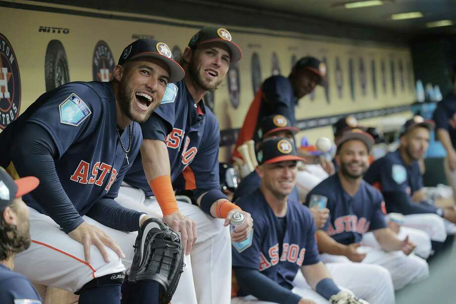 PHOTOS: The world champs return to actionHouston Astros center fielder George Springer (4) laughs with his teammates in the dugout as they watch the team's hype video before their pre-season game against Milwaukee Brewers at Minute Maid Park on Monday, March 26, 2018, in Houston.See how the team looked when they returned to Houston this week for their first home games back since the World Series... Photo: Elizabeth Conley, Houston Chronicle / © 2018 Houston Chronicle