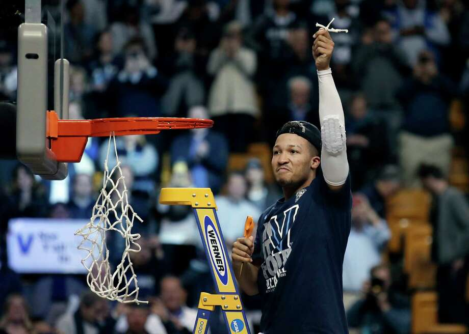 Villanova's Jalen Brunson celebrates after cutting a piece of net following the team's win over Texas Tech in an NCAA men's college basketball tournament regional final, Sunday, March 25, 2018, in Boston. Villanova won 71-59 to advance to the Final Four. (AP Photo/Charles Krupa) Photo: Charles Krupa / Copyright 2018 The Associated Press. All rights reserved.