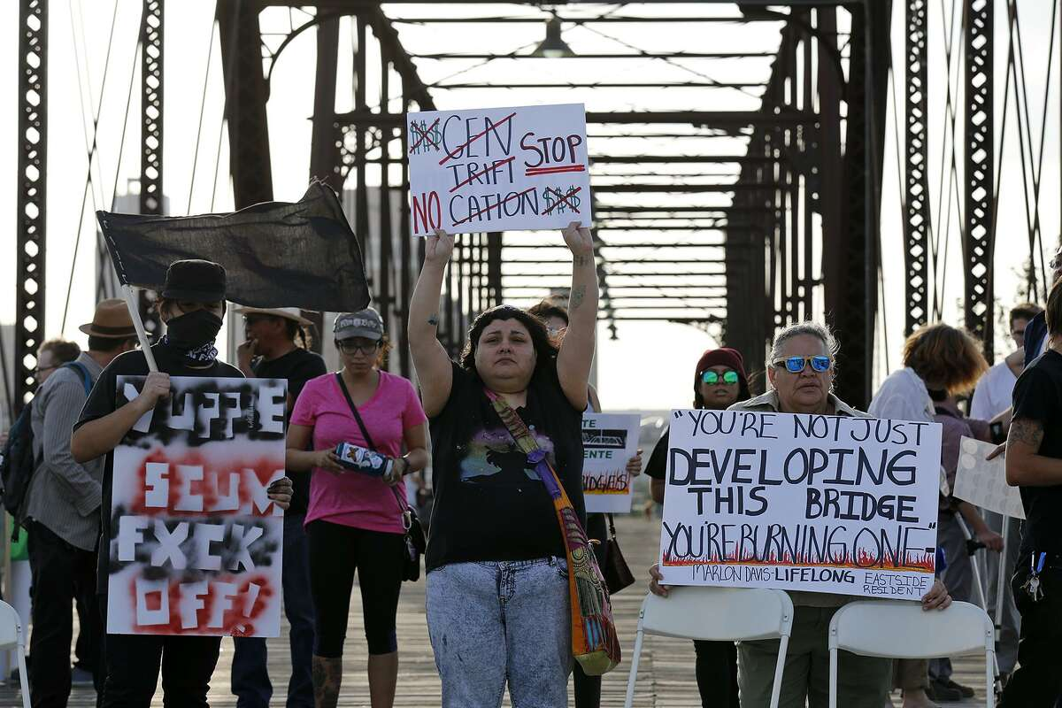 People attend a vigil against the proposed Bridge Apartments held March 26, 2018 on the Hays Street Bridge.