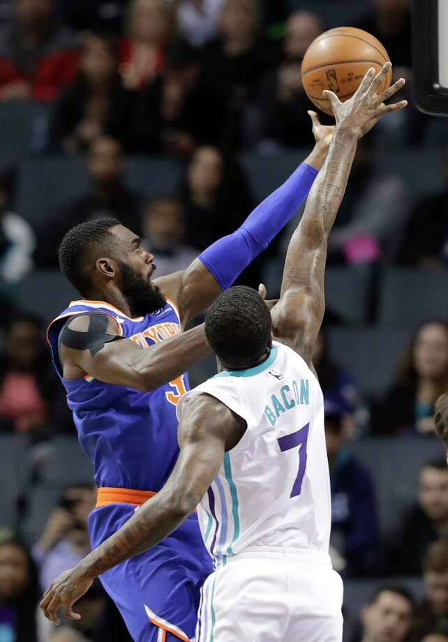 New York Knicks' Tim Hardaway Jr. (3) drives against Charlotte Hornets' Dwayne Bacon (7) during the first half of an NBA basketball game in Charlotte, N.C., Monday, March 26, 2018. (AP Photo/Chuck Burton) Photo: Chuck Burton / Copyright 2018 The Associated Press. All rights reserved.