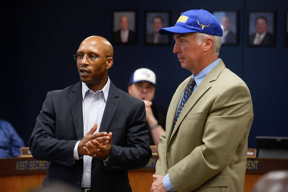 Hamshire-Fannett Superintendent Dwaine Augustine, left, introduces Mark Waggoner as the district's new athletic director and head football coach at their meeting on Monday night. Photo taken Monday 3/26/18 Ryan Pelham/The Enterprise Photo: Ryan Pelham / ©2017 The Beaumont Enterprise/Ryan Pelham