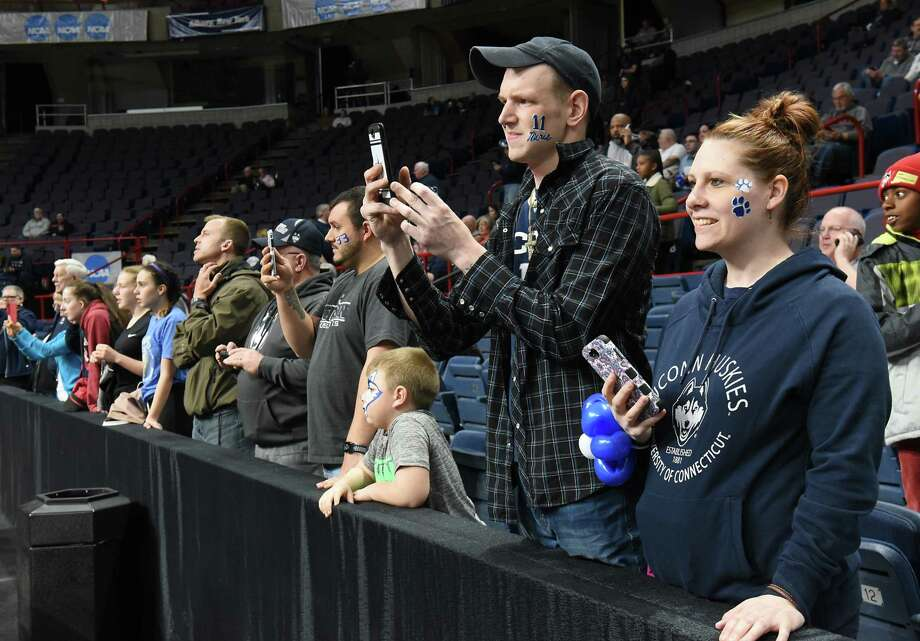 People take photos of UConn practicing with the cameras before the NCAA Women's Basketball regional final between UConn and South Carolina on Monday, March 26, 2018 in Albany, N.Y. (Lori Van Buren/Times Union) Photo: Lori Van Buren / 20043278A