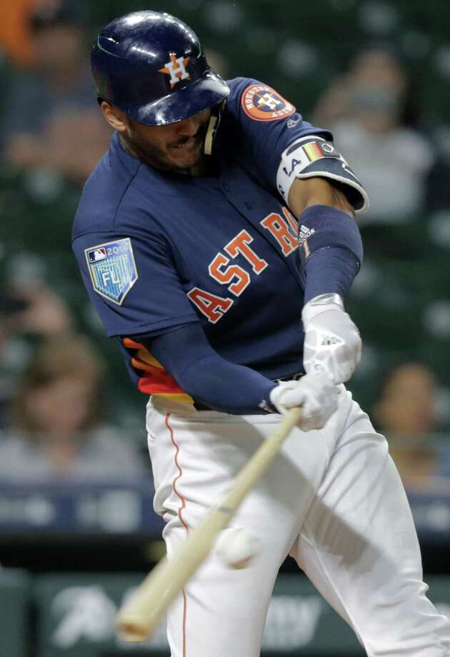 Houston Astros shortstop Carlos Correa (1) connects for a sacrifice single in the fourth against Milwaukee Brewers at Minute Maid Park on Monday, March 26, 2018, in Houston. Photo: Elizabeth Conley, Houston Chronicle / © 2018 Houston Chronicle