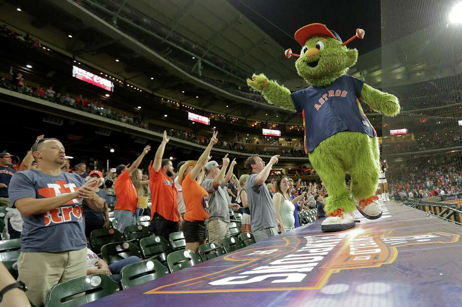 "A Montgomery County woman alleges the Astros mascot Orbit ""shattered"" her finger during a July 2018 game after firing a t-shirt from a ""bazooka style"" cannon into the strands.  Photo: Elizabeth Conley, Houston Chronicle / © 2018 Houston Chronicle"