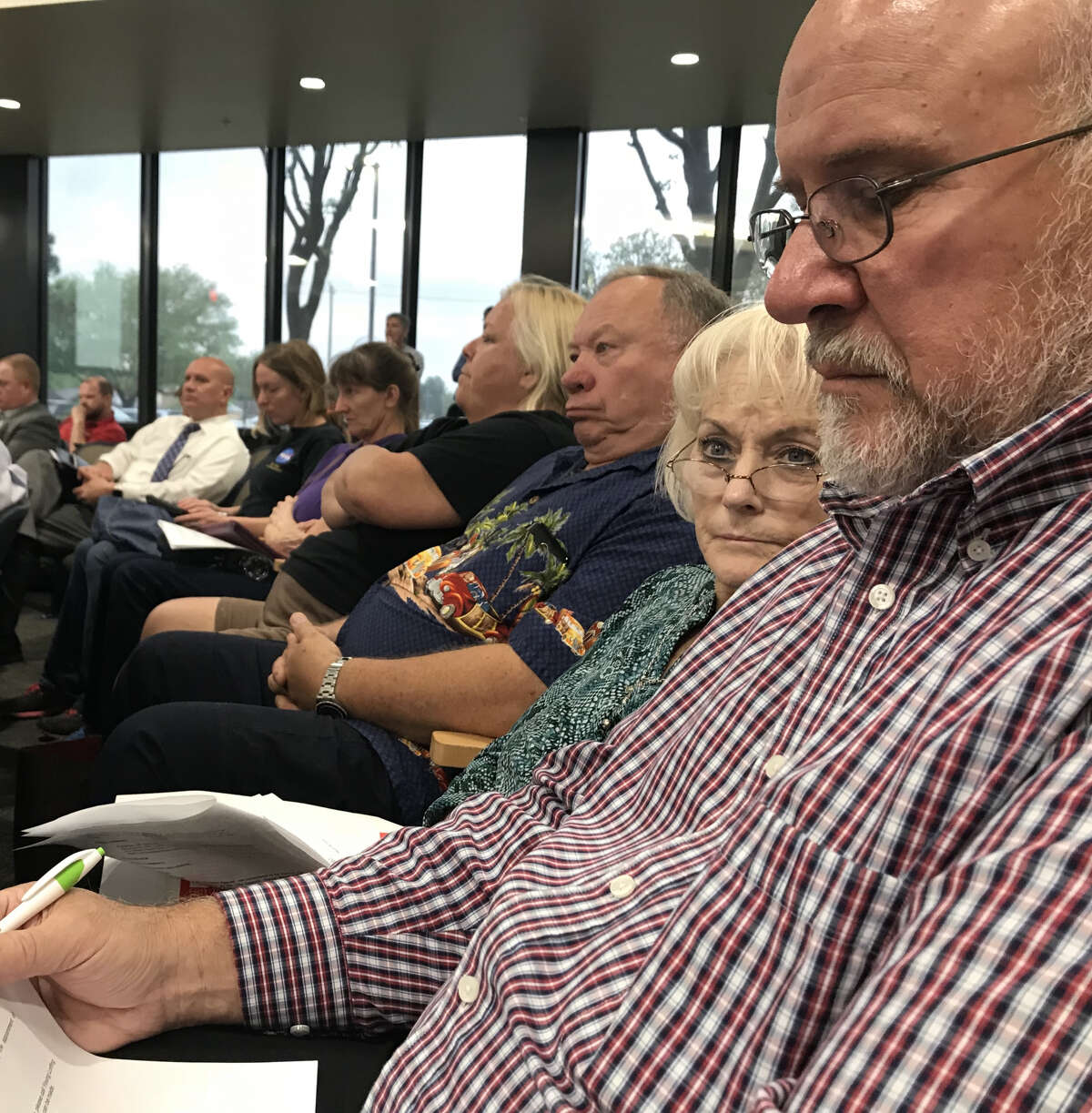 Caye and Gerard Hauser, residents of an area that was annexed by Pearland, attend a hearing last year. The city later repealed the annexation.