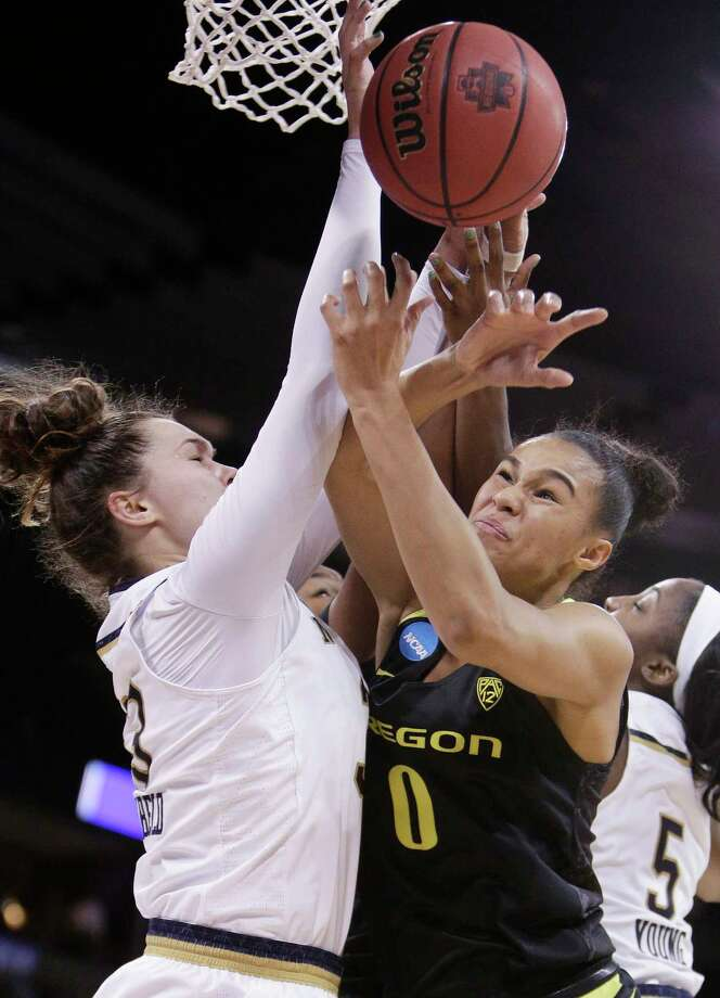 Oregon forward Satou Sabally (0) and Notre Dame forward Kathryn Westbeld go after a rebound during the first half in a regional final at the NCAA women's college basketball tournament, Monday, March 26, 2018, Spokane, Wash. (AP Photo/Young Kwak) Photo: Young Kwak / FR159675 AP
