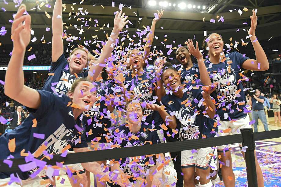 UConn celebrates after winning the NCAA Women's Basketball regional final against South Carolina at the Times Union Center on Monday, March 26, 2018 in Albany, N.Y. (Lori Van Buren/Times Union) Photo: Lori Van Buren / 20043278A